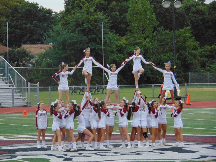 The+cheerleading+team+performs+at+Pep+Rally+before+the+homecoming+game.